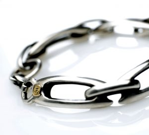 Silver bracelet with 18ct. makers badge. size 8 inches