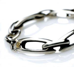 Silver Lozenge bracelet. 18ct. makers badge