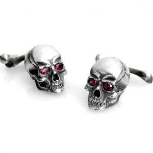 Silver skull and bone cufflinks with garnet eyes